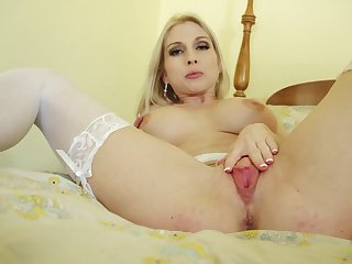 Blonde Christie Stevens with juicy boobs is horny as hell and fucks her love box with her fingers for your viewing pleasure