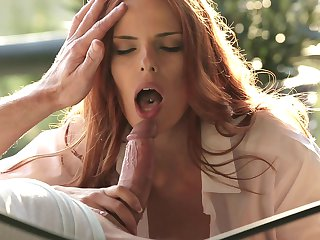 Redhead has fire in her eyes while blowing mans hard meat pole