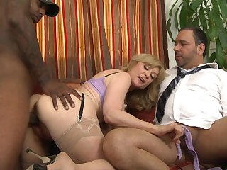 Milf Nina Hartley can't resist the temptation to take Jon Jon's hard worm in her mouth