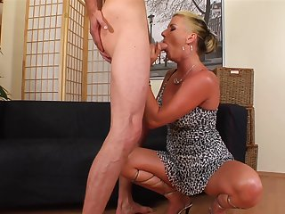 Blonde with giant breasts keeps her mouth wide open while taking cum facial
