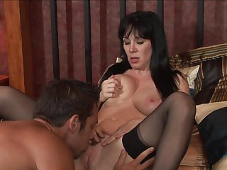 Johnny Castle admires alluring Rayveness's body before she takes his man meat in her mouth