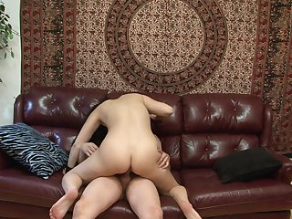 Brunette Angelica Raven has fire in her eyes while sucking mans throbbing meat stick