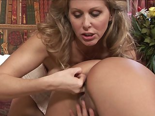Blonde Zoe Britton and Julia Ann fulfill their sexual desires together in lesbian action