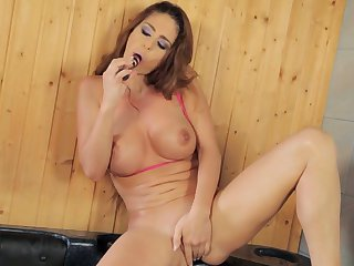 Brunette has fire in her eyes as she plays with herself