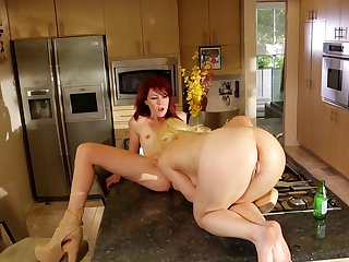 Redhead Elle Alexandra and Ash Hollywood fulfill their sexual desires together in girl-on-girl action