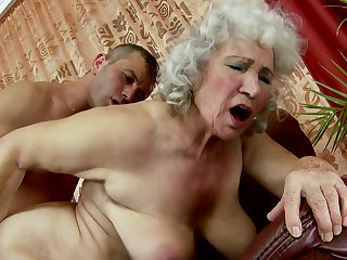 Mature Norma with juicy jugs and hot blooded guy have oral sex on camera for you to watch and enjoy